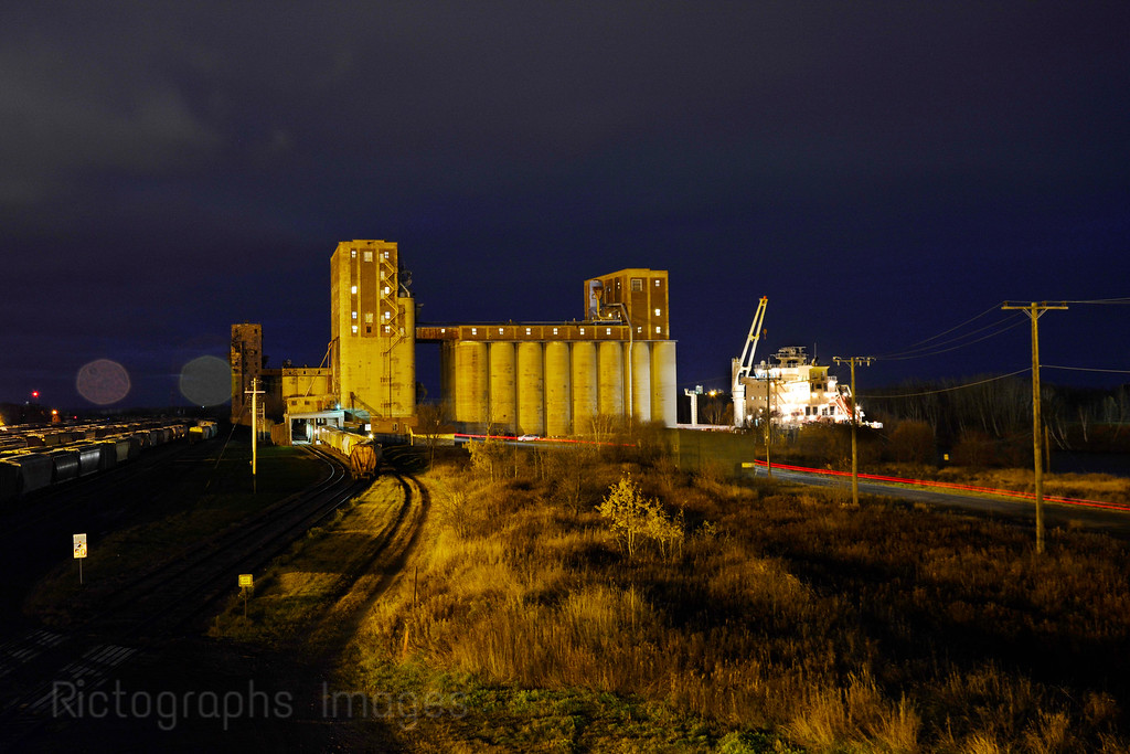 A Grain Elevator Loading A Ship For ExportThunder Bay; Ontario; Canada; 2015, Rictographs Images