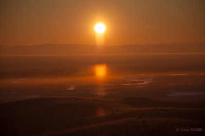 Sun pillar in low clouds over the Tanana River.