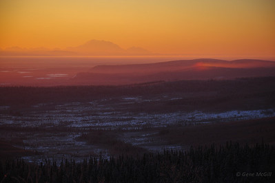 A partial sun dog with Mts. Denali & Foraker 150 miles distant.