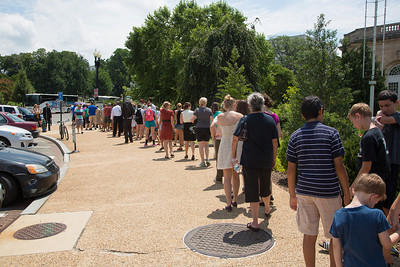 Visitors line up on the sidewalk on Monday July 22 to see the blooming of the giant plant.