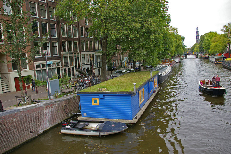 Some of the canals are lined with houseboats of every description.  This one has grass growing on the roof.