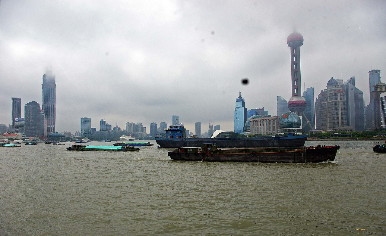 The Shanghai skyline on a wet day.