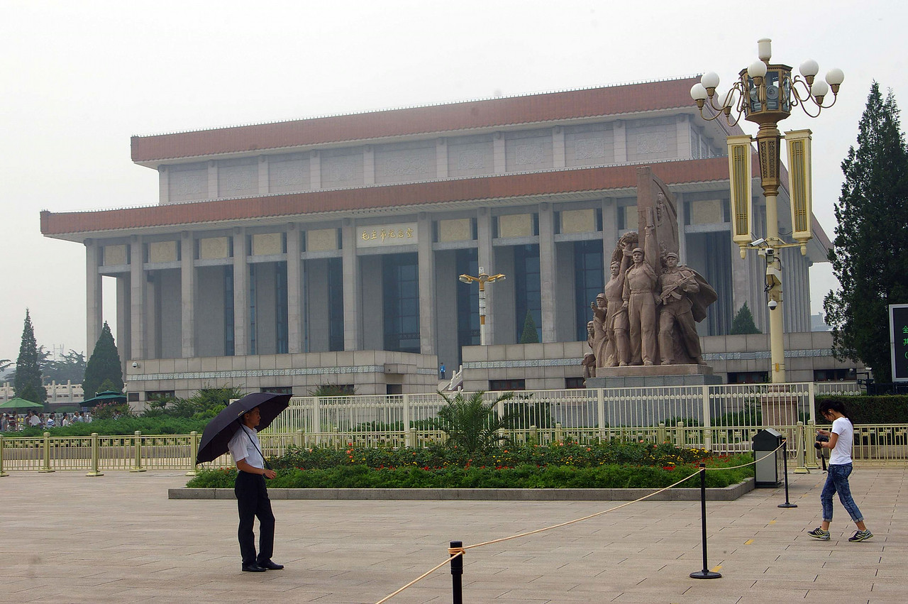 This is the Mausoleum of Mou Zedong.   His embalmed body is raised from it's refrigerated chamber and is on view during the day.