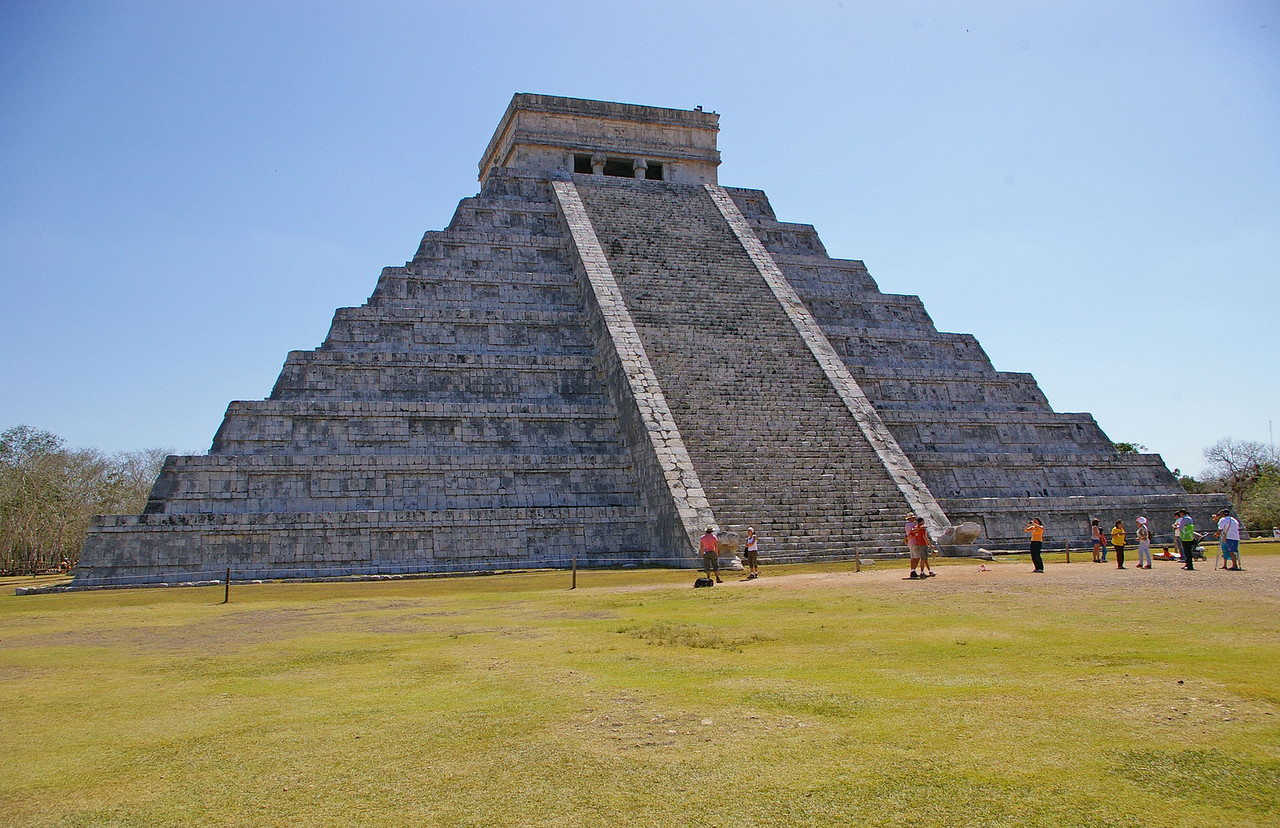 El Castillo. The largest pyramid at Chichen Itza. At the Spring Equinox the sun hits the stepped cornors and casts their shadows on the side of the central stairway appearing to be the feathered serpent god.  The Serpents head is at the botton of the stairways.