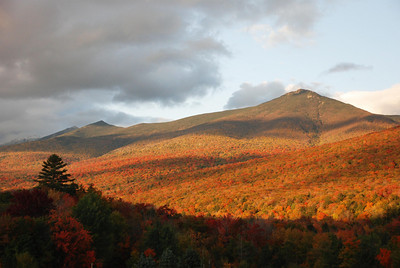 This was taken in the White Mountains Region in NH on 10-4-08. The colors are just peaking here. Note the snow covered peak on the left.