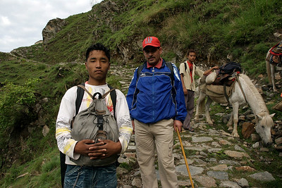 Trekking trail from Jipti to Lakanpur. The person in the blue jacket is our Guide Prakash, person in the forground is Sundar our porter. We trekked about 15 to 20 km. per day for a total of 200 km in 10 days. When I couldn't walk I took the pony seen in the background.