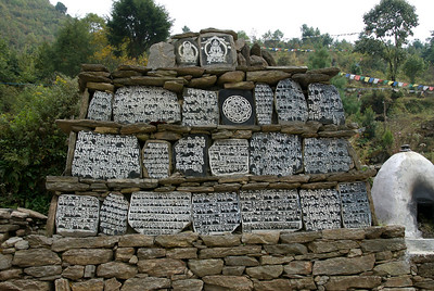 Mani stones on the trekking route to Phakding.