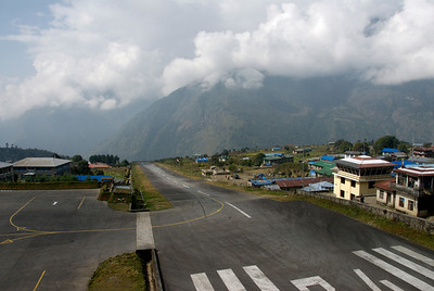 Lukla runway. Notice the ravine at the end of the runway. Control tower on the right side.