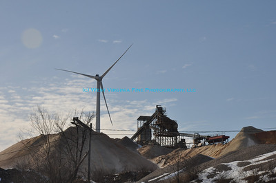 Contrast of old and new.  Limestone quarry is overshadowed by windmill.