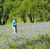 girl picking lupine flowers_P1090552