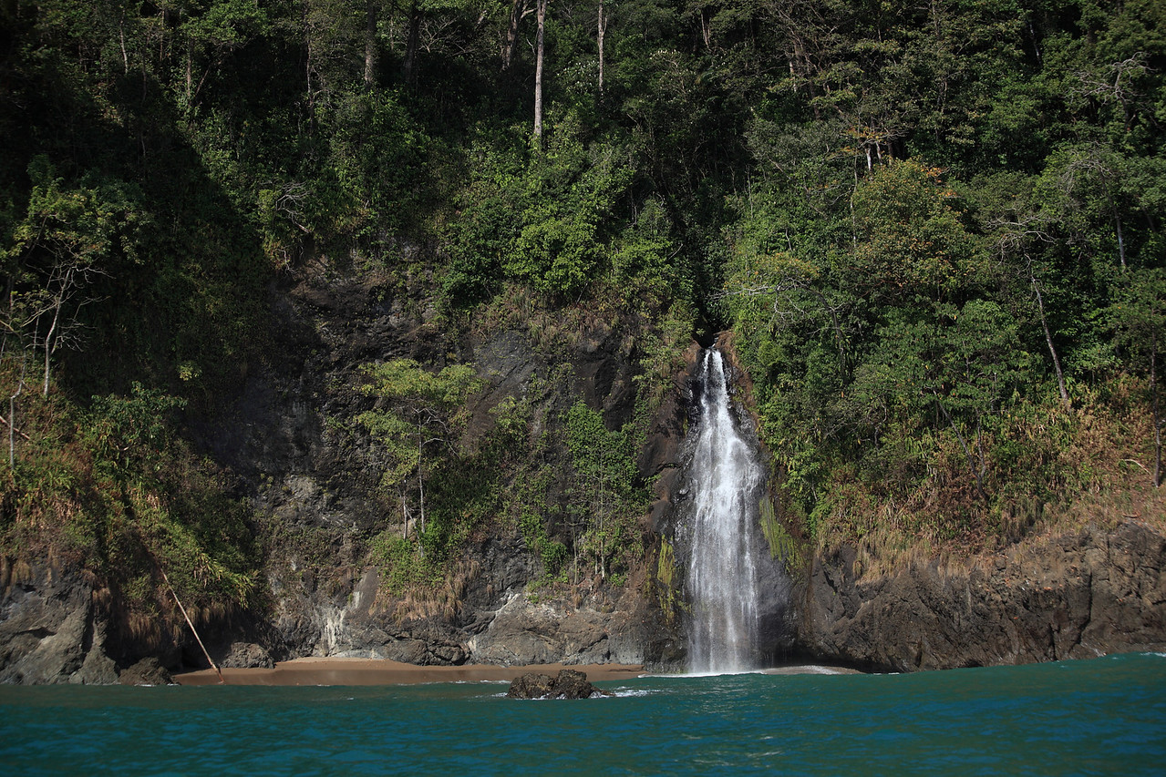 Waterfall onto the beach at Llorona, Corcovado National Park