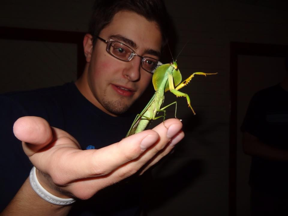 Alex holding a tropical shield mantis (Choeradodis rhomboidea).  Alberto Manuel Brenes Biological Reserve, Costa Rica. Photo by Rachel Kronyak.