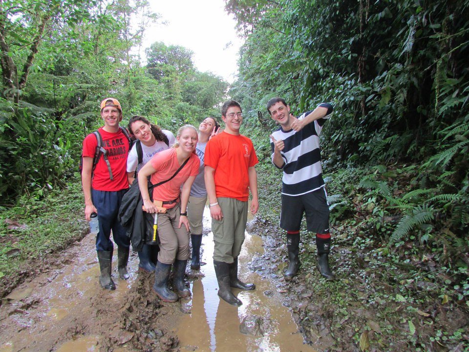 Happy students demonstrating the proper use of rubber boots.  Photo by Rachel Kronyak.
