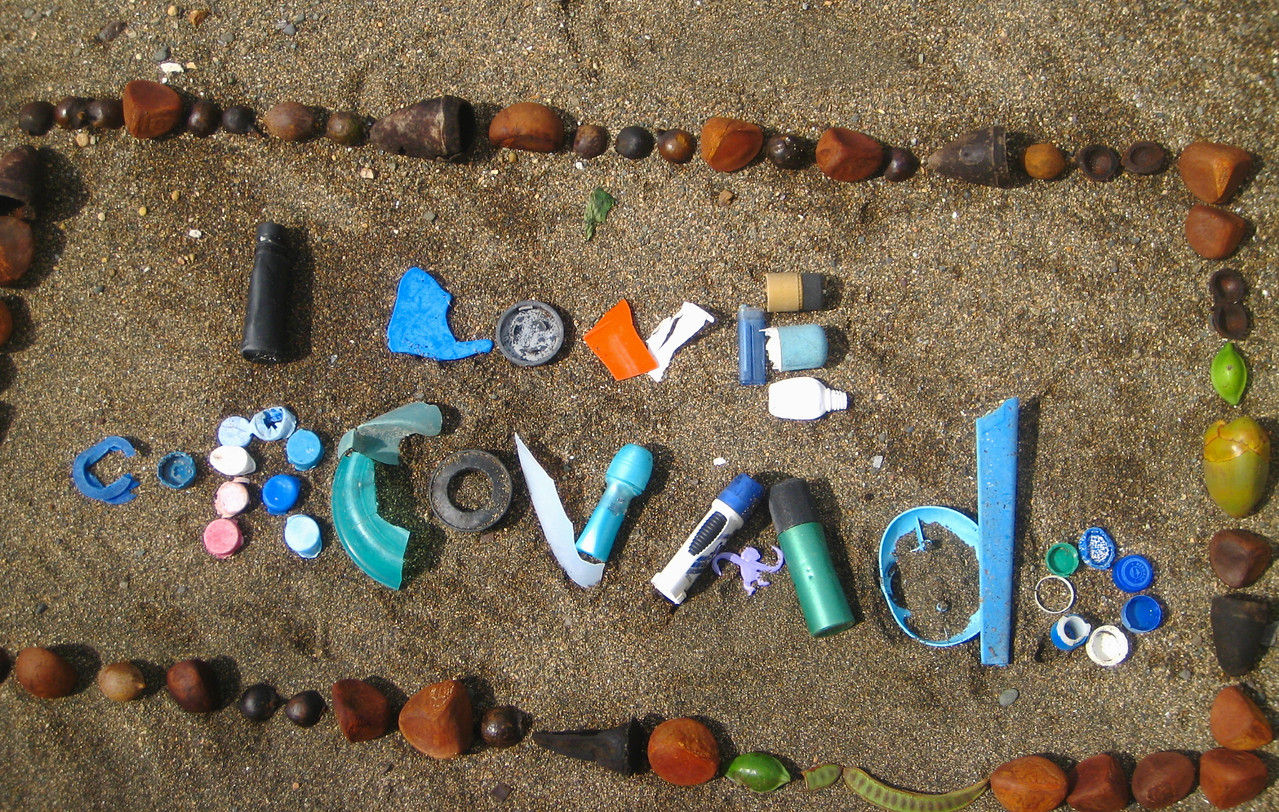 Beach art highlighting the tragic duality between natural beauty (Corcovado National Park, Costa Rica) and the way we degrade even the most beloved parts of our environment.<br /> <br /> The beaches of Corcovado are too remote to easily clean up (although scout groups sometimes collect bags and bags of stuff to be hauled out by boat from San Pedrillo) and are littered with plastic washed ashore from the Pacific.  Especially ironic is the Barrel-Full-of-Monkeys game piece in a park full of wild monkeys.