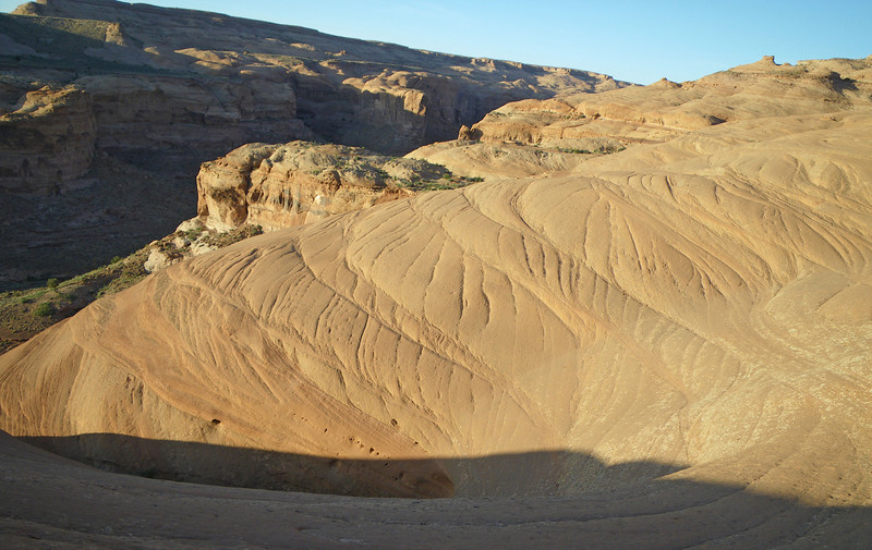 Leaving Larry canyon, hiking up & out on petrified sand dunes.