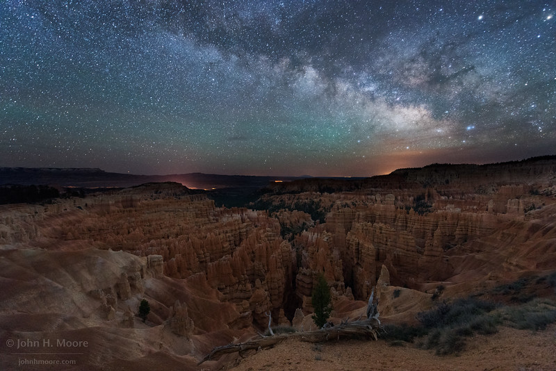 Bryce Canyon hoodoos in the Silent City at night with the Milky Way arcing above.  Bryce Canyon National Park, Utah, USA.