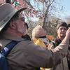 Sally Anderson looks at a Bur Oak acorn cap in Woody's hand