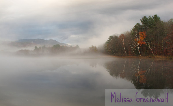 Sunset fog swirling in, on an uncommonly warm October evening, framing Mounts Welch and Dickey above Campton Pond.