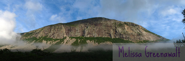 A ribbon of fog wrapped along the talus field of the Cannon Cliffs is all that remained of a dense fog.<br /> <br /> Cannon Cliff forms the eastern flank of Cannon Mountain, and rock climbers frequently scale the mile-long face.  The prominent fold toward the left side of the cliff is the Whitney-Gilman Ridge, one of the most celebrated routes of New Hampshire climbing.