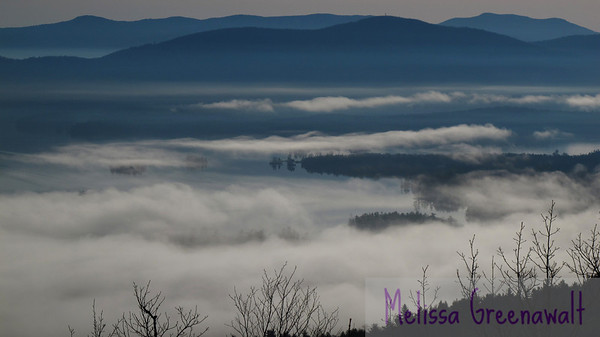 A layer cake of fog, water, and mountain, seen from the summit of Mount Livermore, above Squam Lake.