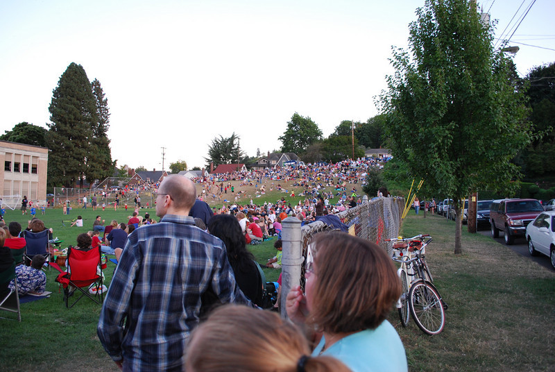 <b>Crowds watching the Vaux Swifts</b>  Sept. 13, 2008<br><br> Once a year, a flock of thousands of Vaux Swifts come to visit Chapman Elementary School in Portland OR, swirling and flying into the chimney of the school nightly for a couple of weeks. Thousands of onlookers picnic and watch the swifts as they fly about.  During the peak of the swifts' annual migration from the Pacific Northwest to wintering grounds in Central America and Venezuela, an estimated 35,000 may roost together in the Chapman chimney, the largest known Vaux's swift roost in the world.