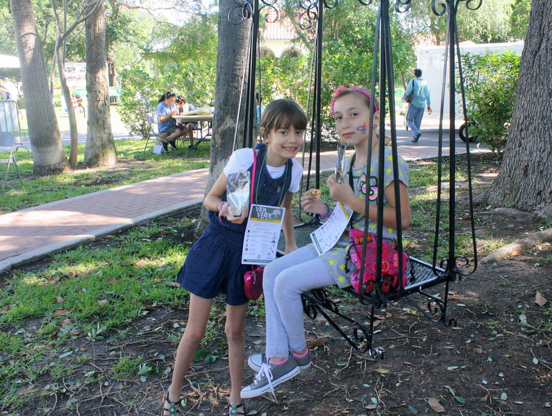 A fun break during all of the activity at the Vida Verde festival is to sit down on the adult sized wrought iron swing.  It hangs down about 15 feet from it's mooring in a tree.
