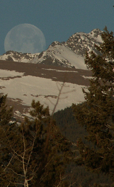 Moonset over the mountains - view from our porch - The moon really did look huge - no other editing was done other than cropping the photo. -Shelley