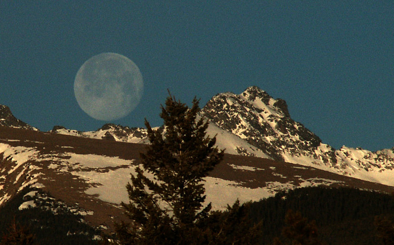 Moonset over the mountains - view from our porch- The moon really did look huge - no other editing was done other than cropping the photo. -Shelley