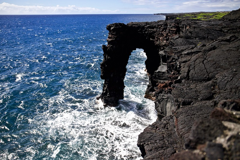 The  90-foot high Hōlei Arch , at the end of Chain of Craters Road, is made of basalt