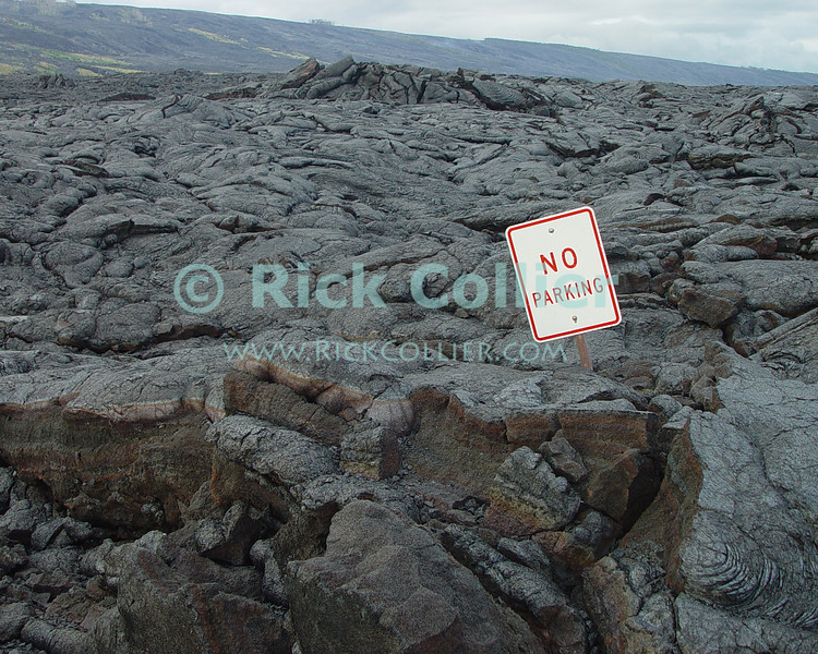 """""""No Parking"""" -- Lava has burried the road, but old traffic signs remain.  Volcanos National Park, the Big Island, Hawaii.<br /> <br /> <br /> <br /> <br /> <br /> <br /> Hawaii Hawai'i big island sea ocean clouds lava flow volcano volcanos national park no parking street sign"""