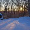 This morning rising sun over frozen landscape... with windchill and very low temps.