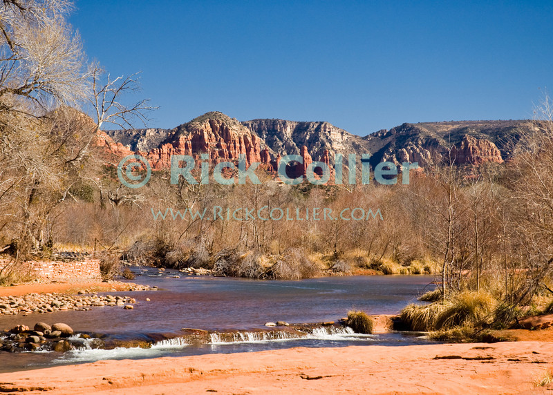 Oak Creek, Sedona, Arizona.  Cottonwood trees frame Oak Creek.  The mesas and buttes that surround Sedona fram the scene in the background.  © Rick Collier<br /> <br /> <br /> <br /> <br /> <br /> <br /> <br /> US USA Arizona Sedona Oak Creek water stream river desert cottonwood trees rest calm relax scenic view rocks rocky shore mesa butte mountain red sand sandy shore