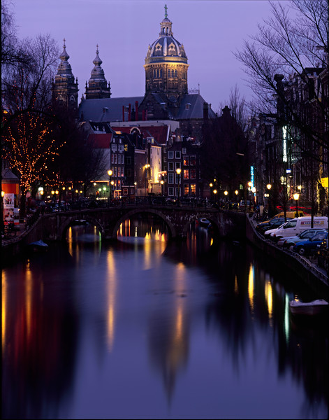 Reflections along a canal in Amsterdam on a very cold, January evening.  The imfamous red light district is on the left bank.  The church was built in the 1500s and is next door to a palace, turned hotel.