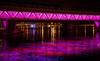 This is the light rail bridge over the Tempe Town Lake, at night.  The lights change colors and patterns.