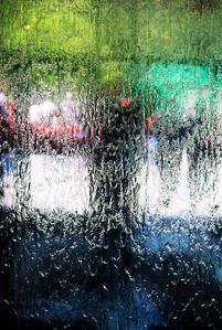 Water running down a glass window