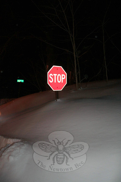 Snow drifts nearly covered the stop sign at the corner of Hall Lane and The Boulevard.  (Hicks photo)