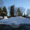 A snow bank in the cul-de-sac at the end of Fir Tree Lane in Sandy Hook is nearly as tall as a temporary shed meant to cover and protect items from snow.  (Hicks photo)