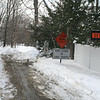 The driver of a large box truck learned the hard way that these signs really meant road closed, after he turned onto Old Mill Road early Friday morning and promptly got stuck on the snow banks that block the road. This photo was taken after the truck had been pulled out of the mess by a large wrecker from Hilario's.  (Hicks photo)
