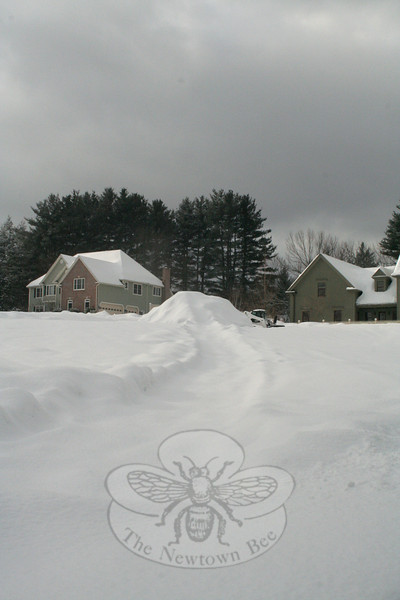 While it's hard to tell from far away, the pile of snow in between these two houses is nearly as tall as the dwellings. It was created by a snow blower being pulled by a skid steer, and made quite a sledding run.  (Hicks photo)