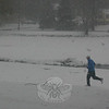 A lone jogger seen in Ram Pasture on February 26 wasn't letting a little snow get in the way of his morning jog.  (Hicks photo)