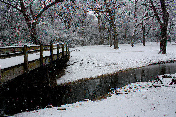 A snow-covered footbridge spanning a creek (2010_02_11_049662)