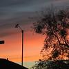 Fiery sky behind anemometer before dawn