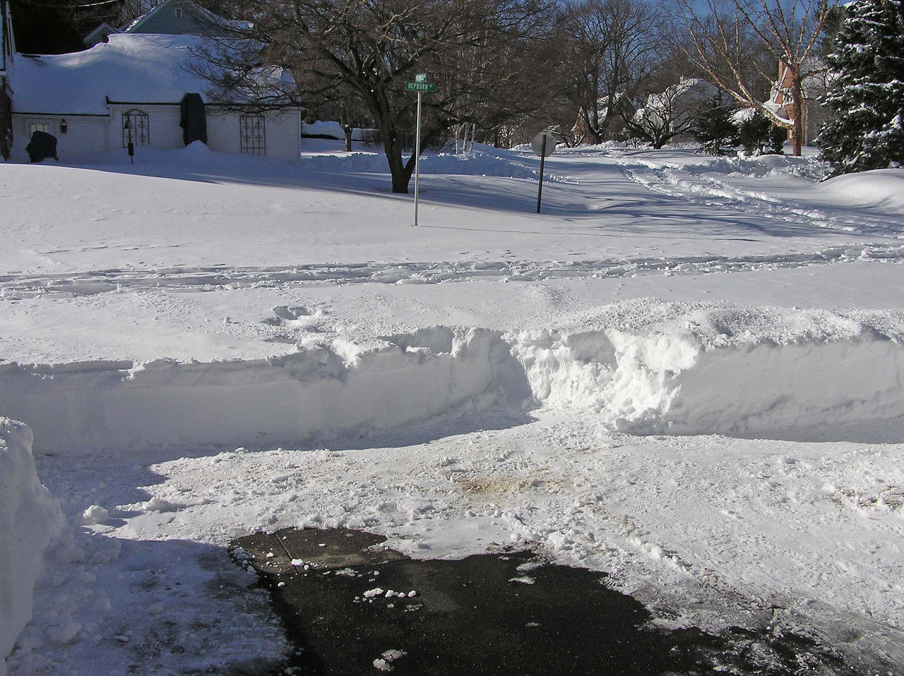 Some people  shoveled  out their driveway but they weren't going anywhere.  This was the third day after the storm.  Joe shoveled all this by hand from the garage out to the street.  I was on the disabled list after falling out of a tree three days  earlier.