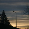 Yellow-orange clouds behind anemometer just before dawn