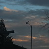 Colorful clouds behind anemometer around sunset
