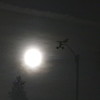 Full Moon behind anemometer