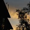 Yellow-orange clouds behind weather instruments