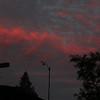 Orange red clouds behind anemometer at dusk