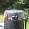 """Test fitting the cut cap on the rain gauge.  Note that the cap cannot be taller than 2-3/8"""" in order to avoid interfering with the instrument mount for the radiation and UV sensors."""