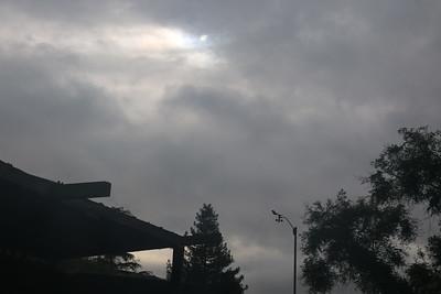 Sun behind overcasts skies behind anemometer